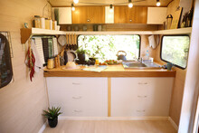 Stylish Kitchen Interior With Different Jars And Utensils In Modern Trailer. Camping Vacation
