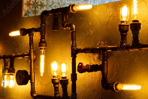 Fototapety, obrazy: Modern led light made from water pipes. Rustic design, stucco wall with light bulbs and pipes