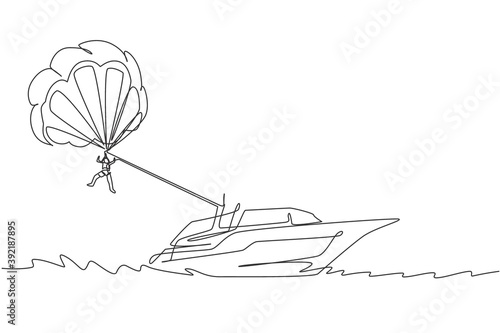Obraz na plátně Single continuous line drawing of young tourist flying with parasailing parachute on the sky pulled by a boat