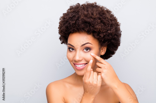 Fototapeta Close-up portrait of her she nice-looking attractive cheerful cheery nude naked wavy-haired girl using inserting eye contact lens isolated on light white gray color pastel background obraz