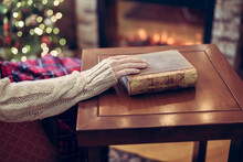 Woman Hand With Old Retro Book...