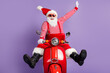 Photo of carefree santa claus ride retro bike wear x-mas costume striped shirt headwear sunglass isolated violet color background