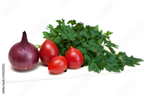 Tomatoes, onions and greens cockerel on a white background Canvas Print