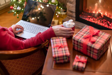 Christmas. Woman Using Laptop ...