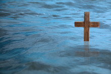 Wooden Cross In River For Religious Ritual Known As Baptism