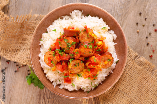 Fotografering creole dish- rougail- sausage with spicy tomato sauce and rice