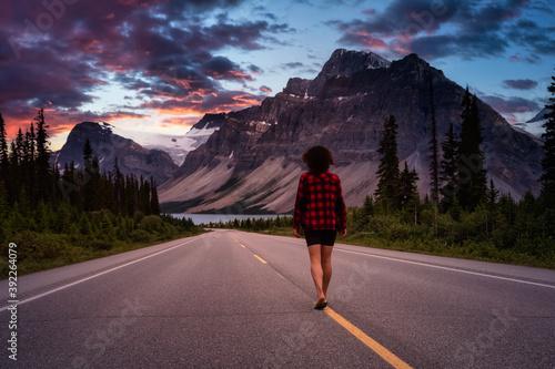Fotografija Girl walking down a scenic road in the Canadian Rockies