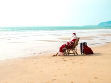 Santa Claus Sits On A Chair Ba...