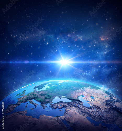 Surface of Planet Earth, space view of the World focused on Europe. The blue light of a comet shining into deep space. 3D illustration - Elements of this image furnished by NASA