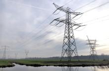 Power Lines In Flat Landscape