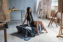 Beautiful Asian Woman With Long Hair Posing For Drawing Class