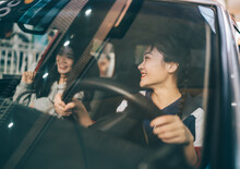 Two Young Female Friends Drive...