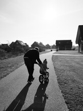 Father Helps Daughter With Push-bike