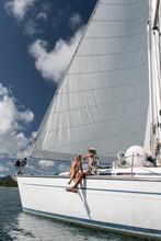 Couple Enjoying Summer Holiday On Sailboat
