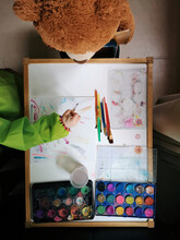 Toddler Painting With Teddy Bear