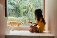 Kid At Home Playing With Cat