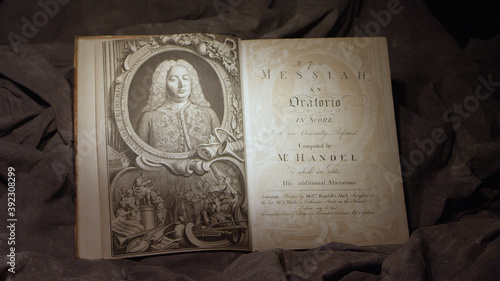 Photo Open book showing Handel's Messiah 1st edition printing from the 1700's