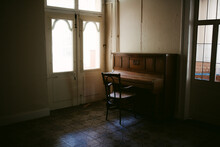 Living Room Of Abandoned House With Chair And Piano