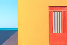 Primary Colors In A Facade And The Sea At Background