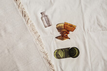 Colorful Glass Cups And Bottle On Canvas Cloth