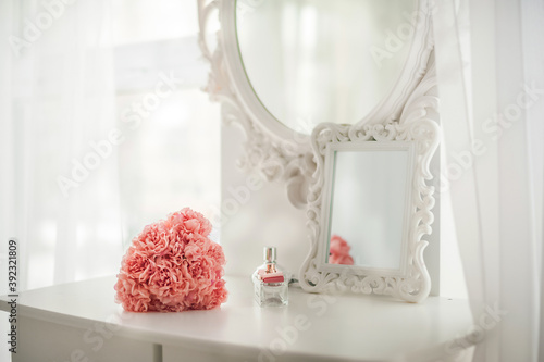Pink flowers on the dressing table in the white bedroom Wallpaper Mural