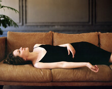 Young Woman Laying On A Sofa