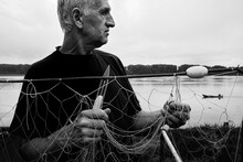 Fisherman Repairing A Fishing ...