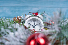 Time Before Christmas Concept. Alarm Clock In Christmas Tree Branch Decorations, New Year