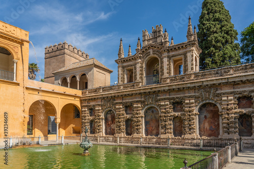 Fotografie, Tablou The Fountain with the historical building with painting in the yard of the Real