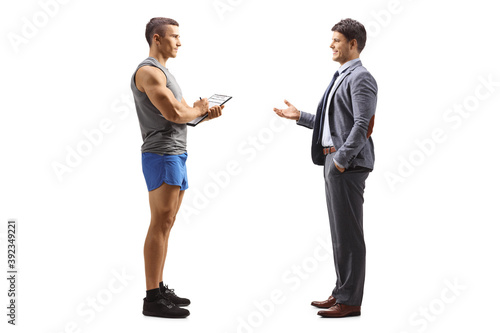 Foto Full length profile shot of a businessman talking to a personal fitness trainer