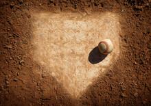 Baseball On Home Plate Of Dirt Baseball Field
