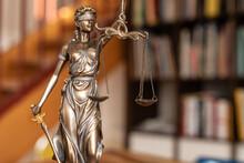 Law Symbol Justice Figure On Wood Table