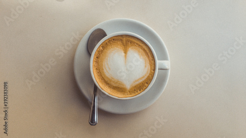 Papel de parede Top view of a cup of delicious cappuccino on white background