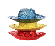 Closeup Shot Of Stacked Straw Hats On A White Background