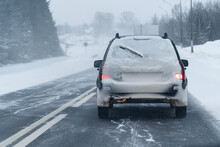 Car Is Driving On A Winter Roa...