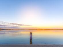 A Girl In Calm Water River Like Uyuni In The Morning Glow