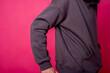 Leinwandbild Motiv parts of hoodie clothing on a multicolored background dressed on men