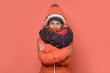 Mature Freezing Woman Wearing Several Scarfs And Hats.