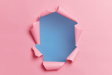 Torn Ripped Pink Background With Hole In Center For Your Advertising Content Or Promotion. Blank Space To Insert Object. Absract Horizontal Shot. Breakthrough Concept. Nobody At Image. Through Paper