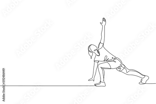 Canvas Print Single continuous line drawing of young sportive woman training side lunge windmill pose in sport gymnasium club center