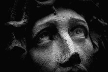 Unbearable Pain In Mind. Close Up Portrait Of Jesus Christ Crown Of Thorns. Fragment Of Very Ancient Stone Statue.