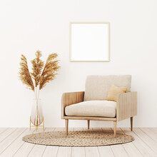 Square Frame Mockup In Warm Living Room Interior With Beige Armchair, Pillow, Wicker Rug, Dried Pampas Grass And Boho Style Decoration On Empty Wall Background. 3D Rendering, Illustration