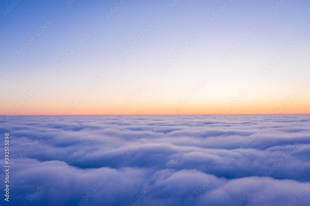Fototapeta Arial view from plane on the sunrise sky