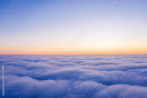 Arial view from plane on the sunrise sky