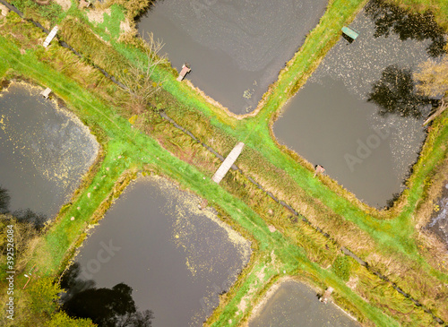 Fotomural Aerial drone view. Fish breeder ponds in the autumn forest.