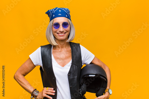 middle age woman smiling happily with a hand on hip and confident, positive, pro Fototapeta