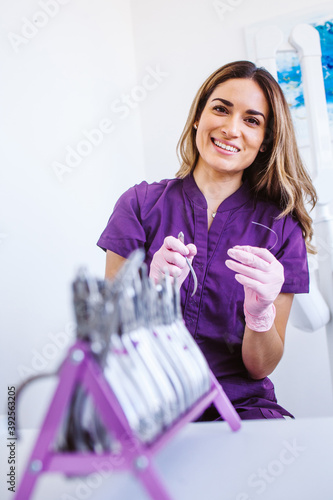 Hispanic dentist with pliers at the clincic in Mexico Canvas Print