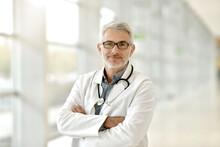 Portrait Of Confident Doctor W...