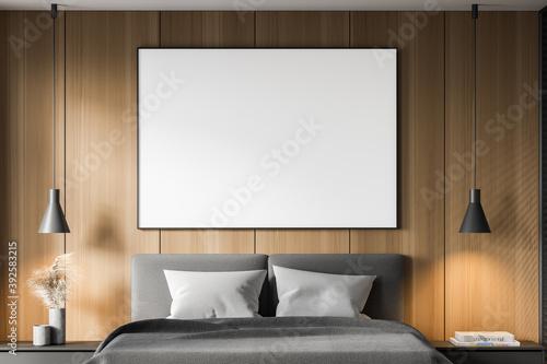 Billede på lærred Wooden master bedroom interior with poster