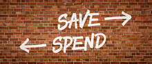 Save Or Spend Written On A Bri...